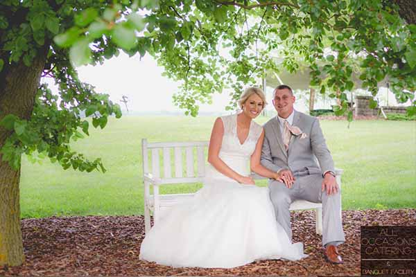 A couple sitting on a white bench in the country in Radnor Ohio